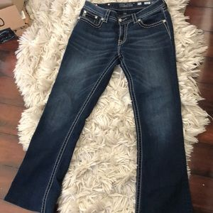 Miss me jeans signifies rise boot cut